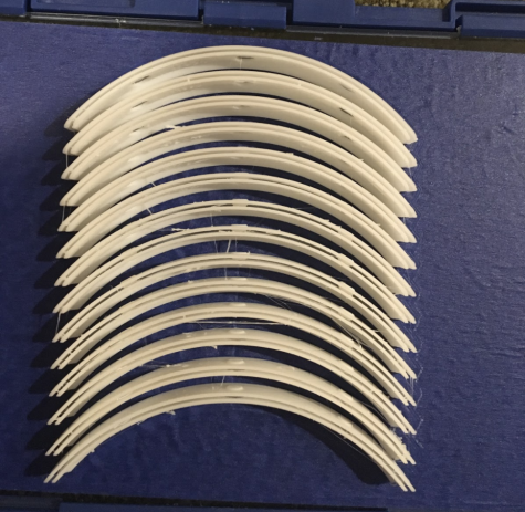 """During this trying time, I wanted to contribute in any way that I could--and I was notified via email of a way I could do exactly that.  This picture depicts a """"batch"""" of 3D printed parts to be used in hospitals for face shields.  It comforts me to know that there are people out there brainstorming ways to use technology to combat the new dangers the world faces on a daily basis."""
